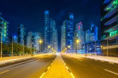 Modern buildings and illuminated road of Dubai UAE Stock Images