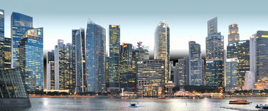 Modern buildings and lights on sea and abstract architectures and night skyline in Singapore. Modern buildings and lights on sea and abstract architectures and Royalty Free Stock Image