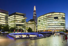 Modern buildings in London at night, editorial. LONDON - AUGUST 20: Night view of several modern glass buildings near City Hall in London with blue night sky on Stock Photos
