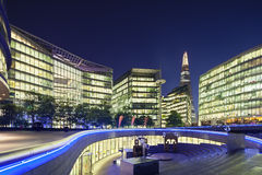 Modern buildings in London at night. Night view of several modern glass buildings near City Hall in London with blue night sky Royalty Free Stock Photo