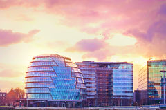 Modern buildings in London at purple sunset stock photos