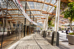 Modern buildings in Milan. Milan, Italy - May 04 2016: Some people walking on the Gae Aulenti square, the commercial district built for the Expo Milano 2015 in Royalty Free Stock Image