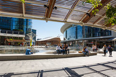 Modern buildings in Milan. Milan, Italy - May 04 2016: Some people walking on the Gae Aulenti square, the commercial district built for the Expo Milano 2015 in stock photography