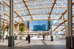 Modern buildings in Milan. Milan, Italy - May 04 2016: Some people walking on the Gae Aulenti square, the commercial district built for the Expo Milano 2015 in Royalty Free Stock Photo