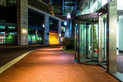Modern buildings at night along a street in Baltimore, Maryland. Stock Photography
