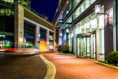 Modern buildings at night along a street in Baltimore, Maryland. Royalty Free Stock Photo