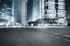 Modern buildings at night and road Royalty Free Stock Photo