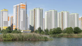 Modern buildings over the water Royalty Free Stock Photography
