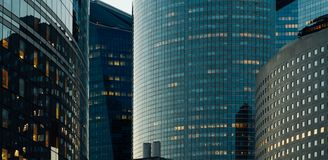 Modern buildings in Paris business district La Defense. Night cityscape with glass facades of skyscrapers. City lights Royalty Free Stock Photography