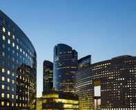 Modern buildings in Paris business district La Defense. Night cityscape with glass facades of skyscrapers. City lights Stock Image