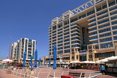 Modern buildings and Ritz-Carlton Hotel on promenade in Herzliy Royalty Free Stock Images