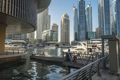 Modern buildings at Dubai creek. Modern buildings and river with boats at Dubai creek, United Arab Emriates Royalty Free Stock Photography
