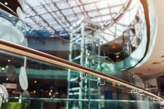 Modern buildings. Shopping center interior design. High tech architecture. Close-up of handrail. Roof and elevator. Modern buildings. Shopping center interior stock photo
