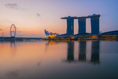 Modern buildings of Singapore skyline landscape in business dist. Rict with sunrise and reflection in water of Marina Bay Stock Photo
