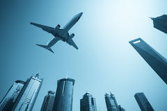 Modern buildings skyline with airplane Stock Image