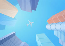 Modern buildings skyscrapers and airplane in the sky. Stock Photography