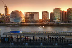 Modern buildings on the south bank of river Thames walk in sunset Royalty Free Stock Photo