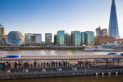 Modern buildings on the south bank of river Thames walk in sunset Stock Images