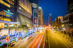 Modern buildings and street at night at Banqiao, in New Taipei C Stock Photos