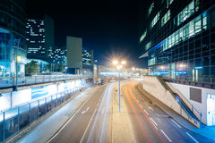 Modern buildings and street at night, in Donau City, in Vienna, Royalty Free Stock Photography