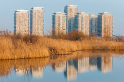 Buildings in the suburbs of Bucharest. Modern buildings reflecting in Vacaresti Lake (delta) near south-eastern Bucharest royalty free stock photos