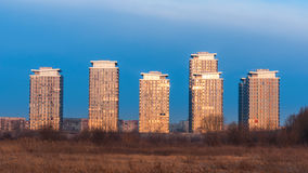 Modern buildings in the suburbs of Bucharest. Modern buildings seen from Vacaresti (delta) in light of sunshine near south-eastern Bucharest Stock Photography