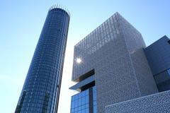 Modern buildings under the blue sky. Modern glass buildings against blue sky with sun rays Stock Photos