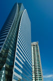 Modern buildings under blue sky. Office modern buildings with beautiful colors with a bright blue sky Stock Image