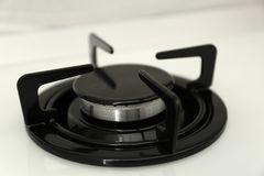 Modern built-in gas cooktop. Kitchen appliance. Modern built-in gas cooktop, closeup. Kitchen appliance stock photo