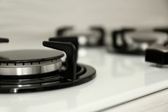 Modern built-in gas cooktop, closeup. Kitchen appliance. Modern built-in gas cooktop, closeup with space for text. Kitchen appliance stock images