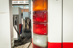 The modern bus at the gas station is tanking diesel royalty free stock photo