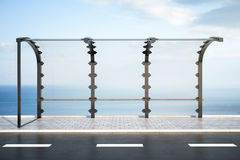 Modern bus stop. On sea and sky background. 3D Rendering Stock Photography