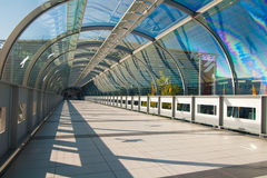Modern business. Architecture. Glass-covered bridge leading to the multi-storey car park Stock Image