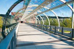 Modern business. Architecture. Glass-covered bridge leading to the multi-storey car park Royalty Free Stock Photos