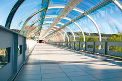 Modern business architecture. Glass-covered bridge leading to the multi-storey car park Stock Image
