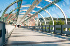 Modern business architecture. Glass-covered bridge leading to the multi-storey car park Stock Photography