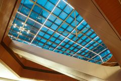 Glass roof  structure of modern commercial building. Modern business architecture with  steel construction and glass roof structure royalty free stock photos