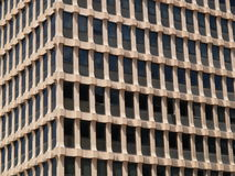 Modern business building. A view of the repetitive pattern formed by windows on the side of a modern, multi-floored office building Stock Photos