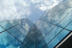 Modern business building. Modern office/business building. Clouds reflection Stock Images
