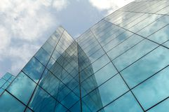 Modern business building. Modern office/business building. Clouds reflection Royalty Free Stock Images