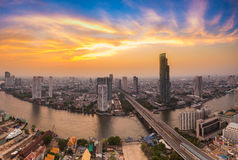 Modern Business Building along the river curve  in Bangkok city Stock Images