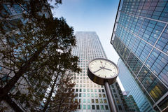 Modern business building in Canary Wharf. Clock in front of shopping mall / business building in Canary Wharf Royalty Free Stock Images