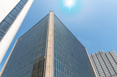 Modern business building glass of skyscrapers with sun Stock Photos