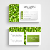 Modern business card with green a triangular pattern Stock Images