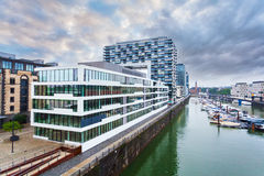 Modern business center on blue sky background in Cologne, Germany Stock Images