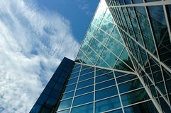 Modern business centre. With a sky reflection Stock Photos