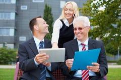 Modern business communication. Modern people business communication with tablet computer and smartphone Royalty Free Stock Photography