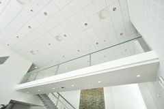 Modern Business Facility Interior. Modern Business Facility White Interior with Transparent Bridge and stairs Stock Photography