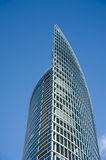 Modern business glass building on blue sky backgro Royalty Free Stock Photography