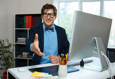 Modern business man with arm extended to handshake Royalty Free Stock Image